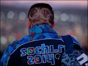 A Canadian fan with Olympic rings shaved into his hair makes his way to the opening ceremonies for the Sochi Winter Olympics.
