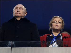 Russian President Vladimir Putin, left, and Russian bobsledder Irina Skvortsova attend the opening ceremony.