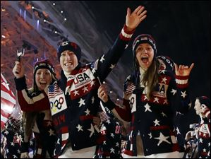The United States team arrives during the opening ceremony.