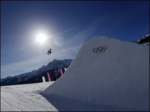 Britain's James Woods takes a jump during ski slopestyle training at the Rosa Khutor Extreme Park  Friday.