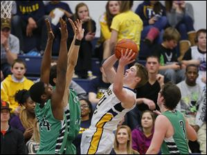 Ottawa Hills basketball players Ellis Cummings (44) Hunter Sieben (11) and Geoff Beans (3) surround Toledo Christian basketball player Kyle Kempton (11).