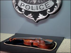 A $5 million Stradivarius violin is displayed at the Milwaukee Police Department Thursday, Feb. 6, 2014, in Milwaukee, a day after police recovered the instrument stolen on Jan. 27 from a concertmaster in a parking lot by a person wielding a stun gun.