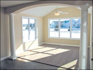 Enjoy this beautiful sunroom which opens to a lovely patio.