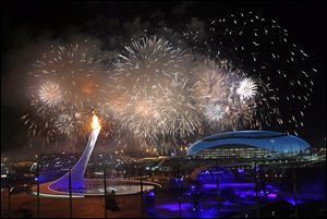 Fireworks light the sky over Olympic Park during Friday's opening ceremony of the Winter Olympics in Sochi, Russia.  It was proclaimed the 'most complex and ambitious technical show ever attempted in Olympic history.'