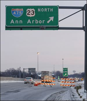 Barricades prevent motorists on Friday from entering northbound I-475 at the U.S. 24 ramp in Maumee.