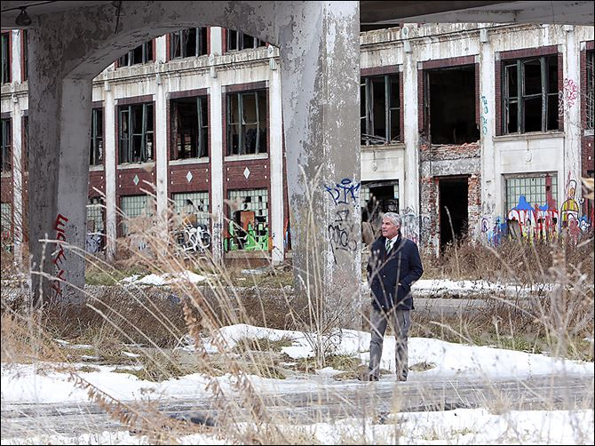 b1fernan-4 A  developer from Lima, Peru, tours  the abandoned  Packard Motors plant  in Detroit in this January photo. The long-vacant plant has become an international symbol of urban decay.