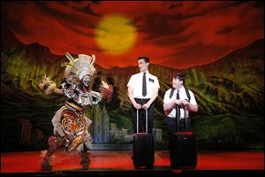 Elder Price and Elder Cunningham arrive in Uganda in a scene from 'The Book of Mormon.'