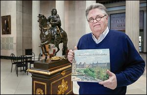 Dick Putney, exhibit curator and art history professor at UT, holds 'The Art of the Tuileries Garden,' for which he contributed an essay. He says artists have been drawn to the space for centuries.
