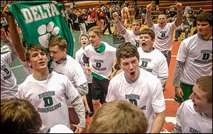 Delta High School wrestlers celebrate their win over Dayton Christian, which gave the Panthers back-to-back victories in the state duals meet.