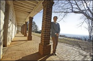Leslie Greene Bowman president and CEO of the Thomas Jefferson foundation, poses along the south terrace near the kitchen of Thomas Jefferson's Monticello  in Charlottesville, Va.