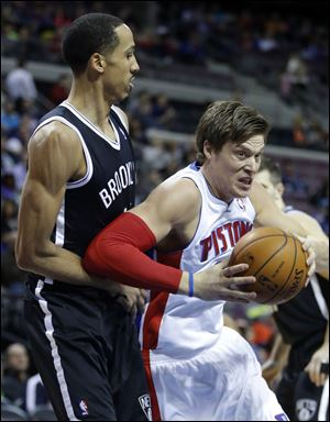 Detroit Pistons forward Jonas Jerebko, right, of Sweden, drives to the basket against Brooklyn Nets guard Shaun Livingston.