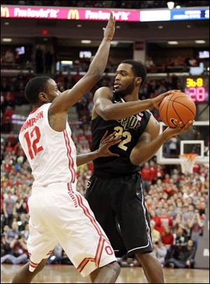 Ohio State's Sam Thompson (12) guards Purdue's Errick Peck (32) during the first half.