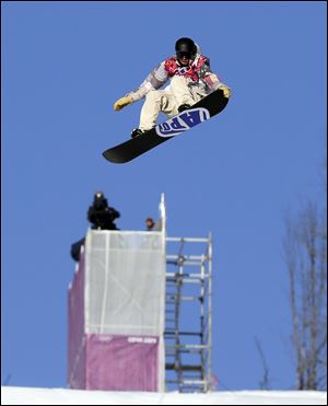 United States' Sage Kotsenburg takes a jump during the men's  snowboard slopestyle semifinal Saturday at the Rosa Khutor Extreme Park in Krasnaya Polyana, Russia.