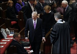 Former Vice President Walter Mondale arrives at the memorial service for his wife, Joan Mondale, at the Westminster Presbyterian Church in Minneapolis, followed by former President Jimmy Carter and former first lady Rosalynn Carter.