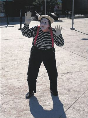 Sherry Stanfa-Stanley performs as a mime at a Kentucky shopping center.