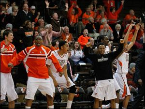 The BGSU bench and fans erupt after Jehvon Clarke's 3-point shot tied the game late.
