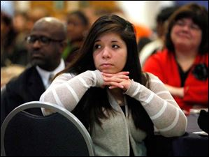 Sylvania Southview High School senior Nina Martinez listens.