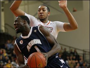 Akron's Demetrius Treadwell leans in front of BGSU's  Cameron Black.