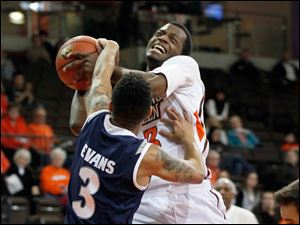 The Falcons' Spencer Parker drives against Akron's Nyles Evans. It was called a jump ball.