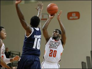 BGSU's Jehvon Clarke shoots a 3 over Akron's Nick Harney to tie the game at 63 in the final minute.