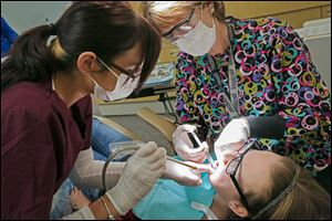 Heather Blair, a certified dental assistant, left, and certified hygienist Kelly Bar