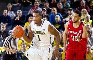 Michigan's Glenn Robinson III gets past Nebraska's Walter Pitchford. The Wolverines have lost two of their last three games.
