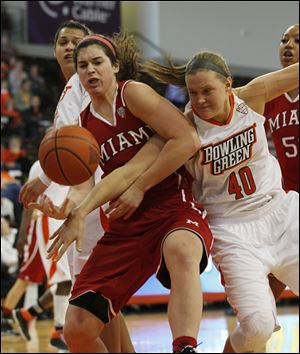 Miami's Nicole Anderson and Bowling Green's Jill Stein vie for the ball. With Sunday's lopsided victory over the RedHawks, the Falcons improved to 10-1 in Mid-American Conference play.