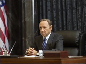 Kevin Spacey stars as Francis Underwood in a scene from 'House of Cards.' The second season of the popular Netflix series premieres on Friday.