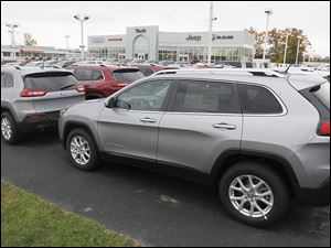 "Toledo-built Cherokees are lined up at Yark Jeep.  Consumer Reports criticized the vehicle for being ""underdeveloped and unrefined,"" and for not getting the ""fundamentals right for everyday use."""