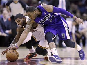 Cleveland's Kyrie Irving, left, and Sacramento's Marcus Thornton chase down a loose ball during the third quarter on Tuesday.