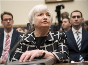 Federal Reserve Chair Janet Yellen listens on Capitol Hill in Washington today while testifying before the House Financial Services Committee hearing.