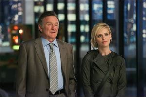 Robin Williams, left, and Sarah Michelle Gellar in a scene from the pilot episode of