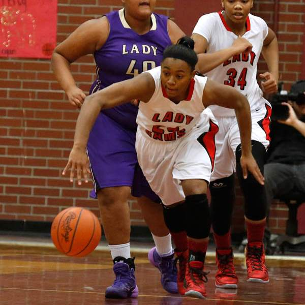 Rogers-Brelynn-Hampton-Bey-steals-the-ball-from-Waite