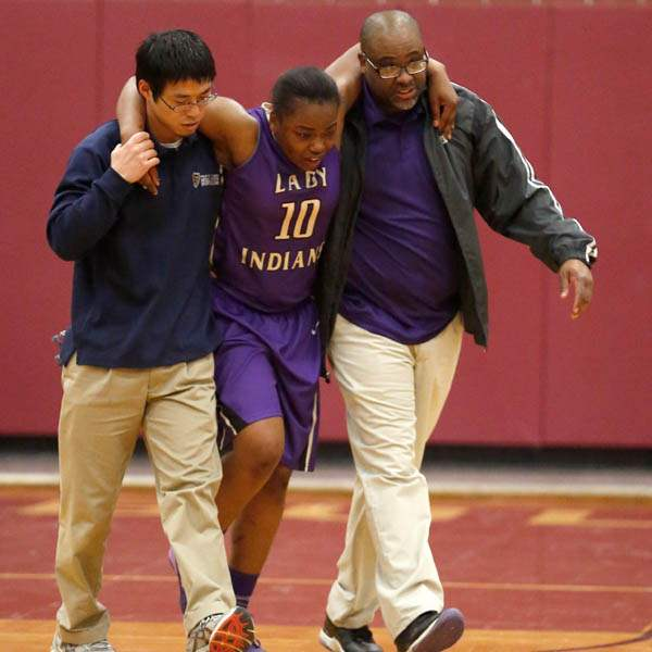 Waite-s-Ramiyah-Henry-is-escorted-off-the-court-by-UTMC