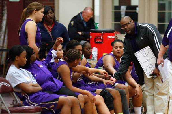Waite-head-coach-Manny-May-consoles-his-team-as-they-trail