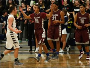 Lake's Connor Bowen celebrates a foul that's opposed by Rossford's Derek Mack, 10.