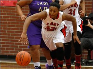 Rogers' Brelynn Hampton-Bey steals the ball from Waite.