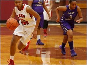 Rogers' Tori Easley dribbles down the court during 2nd half.