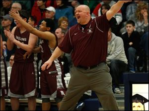 Rossford head coach Brian Vorst yells instructions.