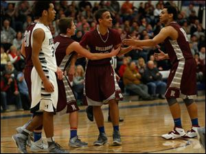 Rossford's Derek Mack, center, celebrates being fouled by Lake's Brandyn Neal.