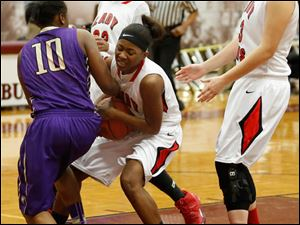 Waite's Ramiyah Henry and Rogers' Sasha Dailey fight for a ball.
