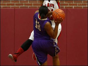 Waite's Ramiyah Henry is fouled by Rogers' Brelynn Hampton-Bey.