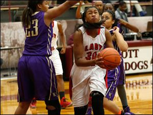 Waite's Taylor Works guards Akienreh Johnson.