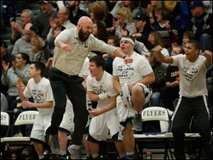 Lake head coach Ryan Bowen jumps up in excitement as his team takes a large lead.