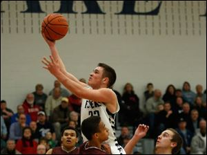 Lake's Connor Bowen flies over Rossford defenders.