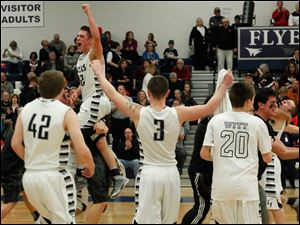 Lake's Connor Bowen is lifted in the air while his teammates Nathan Permar, 42, Jared Rettig, 3 and Aaron Witt run onto the court after defeating Rossford.
