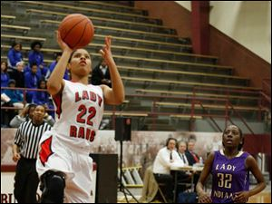 Rogers' Jasmyne Smith drives in front of Waite's YaTia Caldwell.