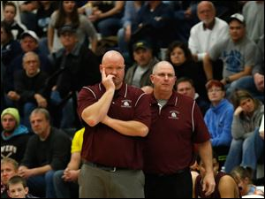 Rossford head coach Brian Vorst, left, watches his team trail.