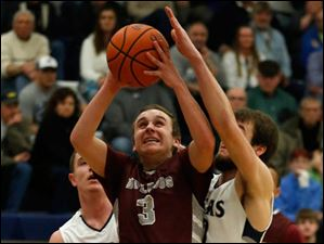 Rossford's Mack Miller is guarded by Lake defenders Jared Rettig, left, and Todd Walters during 2nd half.