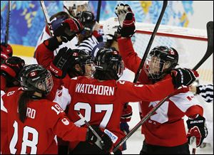 Hayley Wickenheiser of Canada, right, celebrates with her teammates after her goal against the Unites States during the third period.